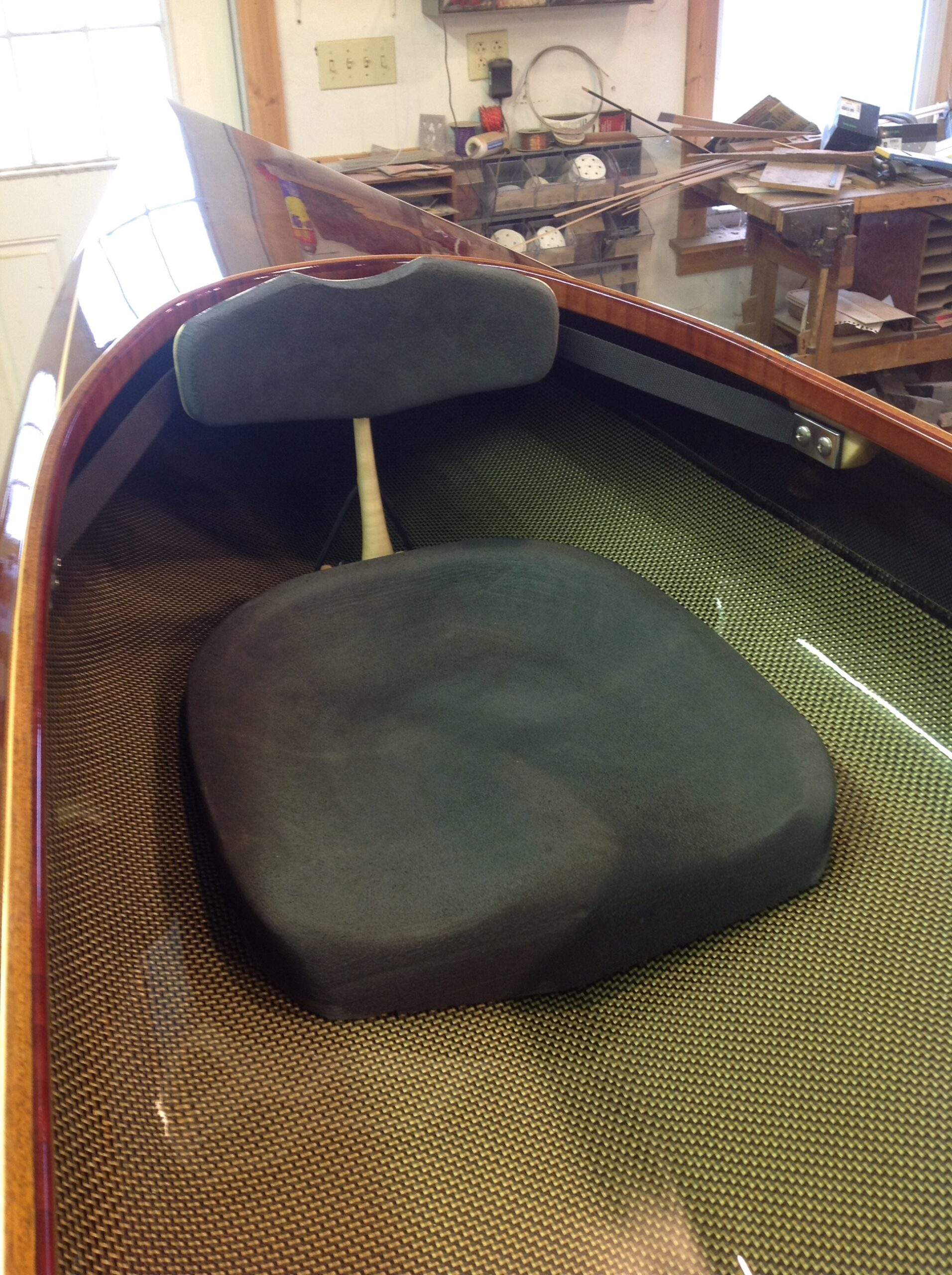 Foam seat fitted in western red cedar kayak