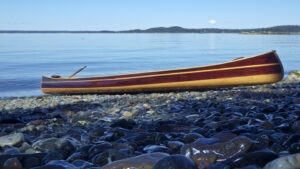 Mystic River Tandem Wood Strip Canoe on Maine Beach