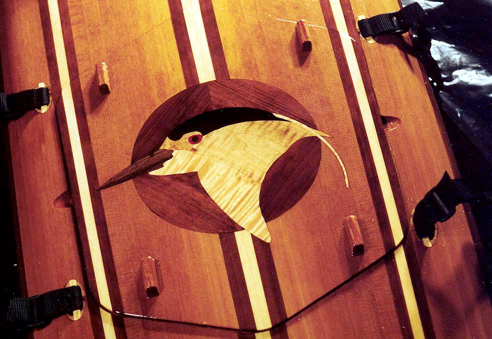 Black Crowned Night Heron inlay on back deck of a wooden kayak
