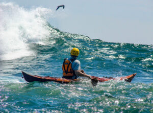 Petrel Wooden Kayak in Big Wave