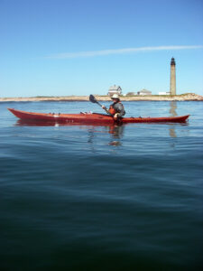 Paddling the Petrel Wood Sea Kayak past Pettit Mannan Lighthouse
