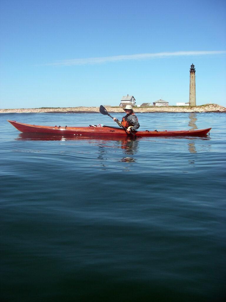 Paddling the Petrel Wood Sea Kayak past Pettit Mannan Lighthouse