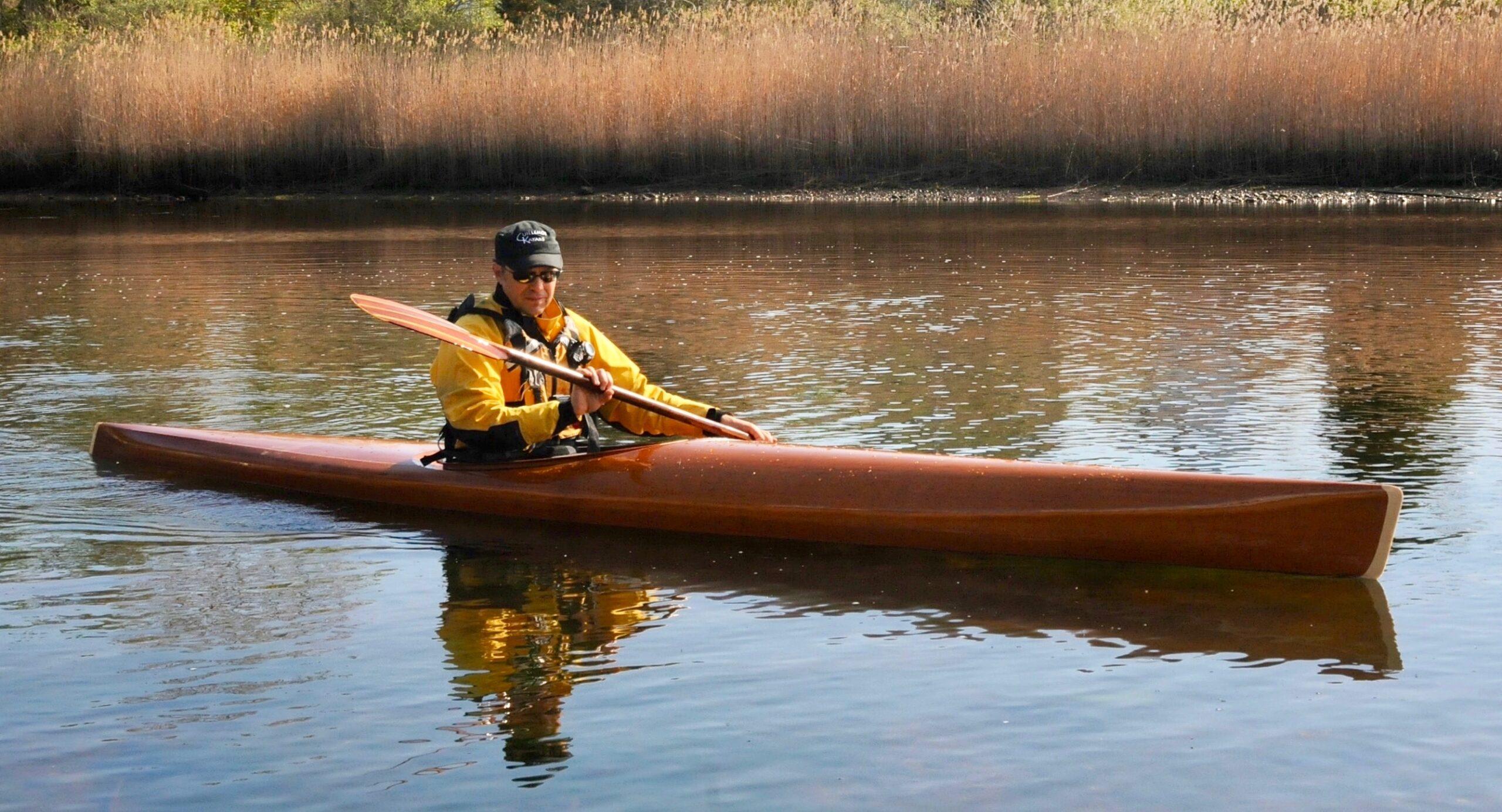 microBootlegger Sport mahogany wooden kayak on the water - Built by Nick Schade - Guillemot Kayaks